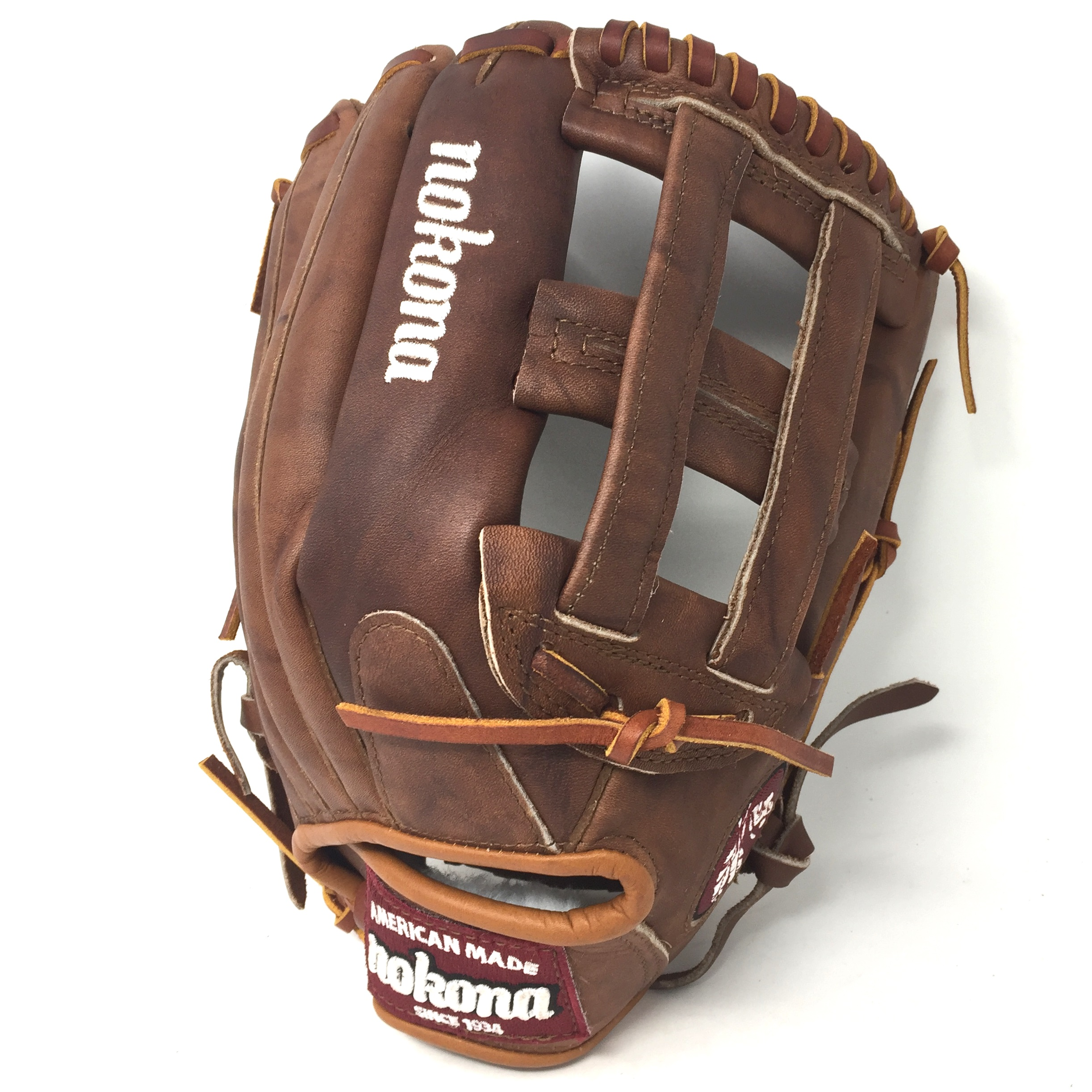 Nokona built its reputation on its legendary Walnut Leather and the Walnut Classic Series. Entering into a new era of Nokona gloves, the Nocona, Texas-based company is switching things up with the introduction of its new Walnut HHH Leather. Walnut HHH is a beefed up version of the Walnut Classic Leather for sturdier performance that some players prefer. The Triple H indicates a leather that is between 5.2 and 6 ounces, making these new Walnut gloves some of the stiffest that Nokona manufactures. Walnut HHH maintains the character, look, and feel of Nokona's classic Walnut, but with a stiffer feel. Once a Walnut HHH glove is broken-in, players are left with a glove that is soft and supple, yet remains sturdy - a true, classic.