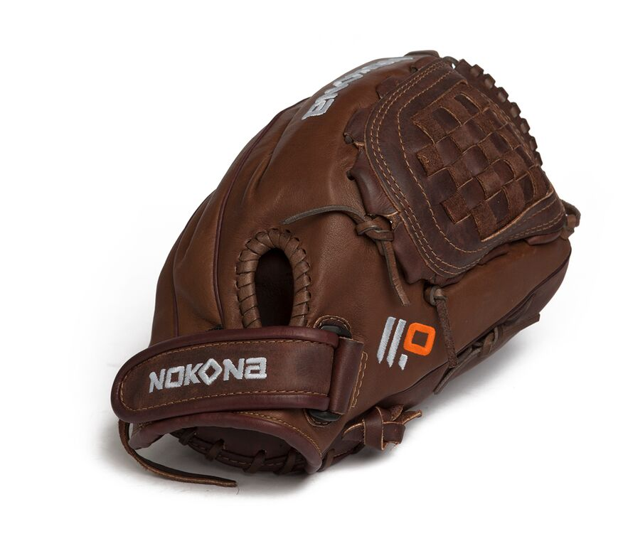 """Nokona X2 Elite Fast Pitch Softball Glove. Stampeade leather close web and velcro closure back. Nokona Elite performance ready for play position specific series designed with specific fastpitch patterns. The X2 Buckaroo is made with Nokona proprietary top grain stampede steerhide and kangaroo leathers so that minimal break in is need, but the glove has great structure and maintains its shape. For elite fastpitch players who are looking the the perfect combination of top quality and highest performance. TOP QUALITY FOR HIGH PERFORMANCE: The X2 Buckaroo X2-1300 is designed for an outfielder that demanded only the best from themselves and from their equipment. The glove features a deep pocket, perfect for catching pop ups with ease, even for softball players. Never miss a ball with this beautiful outfielder's glove. MINIMAL BREAK IN NEEDED: The X2 Elite is made with Nokona's proprietary top-grain Stampede Steerhide and Kangaroo leathers, so that minimal break-in is needed, but the glove has great structure and maintains its shape. It gives you all the performance of the glove you want so you can get on the field with your favorite glove in no time. INCREDIBLE COMFORT: With just a weekend of play, you can be ready for a game on Monday with this glove. It features some of the best leather on the market to protect your hand and enhance your catching. This glove is designed to give you everything you need in a glove and is built to last as long as you're still playing. AMERICAN BALLGLOVES: Nokona is focused on the future, applying many of the same principles that have guided our past – quality, craftsmanship, innovation, integrity, and a commitment to our employees, suppliers, customers, and our country. We continue to put classic American workmanship into every glove, using techniques developed over the past 80+ years. PRODUCT SPECIFICATIONS: Package contains (1) Nokona X2 Buckaroo X2-1300 Elite Closed Web, For Right Handed Throwers. 12.00"""" Pattern. Closed Web. Open Back."""